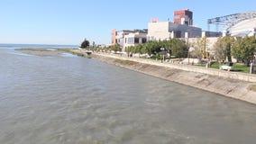 Embankment of the river Mzymta in Adler, Krasnodar Krai, Russia. Adler, Russia - March 8, 2016: Adler is a resort area near Sochi, Krasnodar Krai, Russia stock video