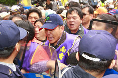 Administration. Protesters attempt to break the line of police on Dec. 23,2008 in Taipei. They urge the authorities to penalize businesses that force employees Stock Photo