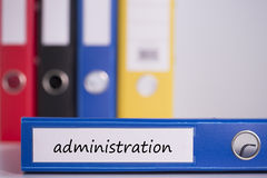 Administration on blue business binder. The word administration on blue business binder stock image