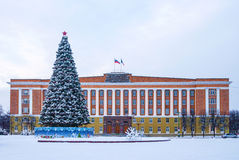 Administration Building and the New Year tree in winter scene Stock Photos