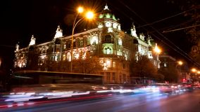 Timelapse. Administration of the city of Rostov-on-Don at night, beautiful lighting of the building traces from car headlights