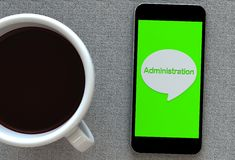 Administration, message on speech bubble with smart phone and and coffee Royalty Free Stock Photo