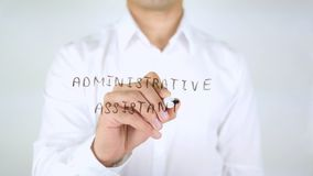 Administrative Assistant, Man Writing on Glass, Handwritten. High quality Stock Image