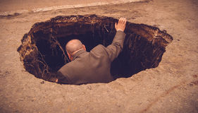 Administrative Man Evaluate a Big Hole Catacombs Stock Image
