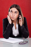 Administrative tired woman. Speaking on the phone Stock Images