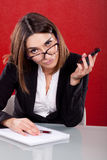 Administrative woman feeling tired. Young executive woman feeling tired at work Stock Photography