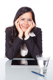 Administrative woman smiling. And looking to the camera Stock Photography