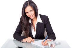 Administrative young woman. Sitting at a desk Royalty Free Stock Photos