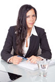 Administrative young woman. Sitting at a desk Stock Image
