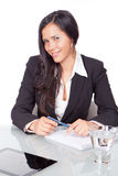 Administrative young woman. Sitting at a desk Stock Photos