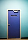 Administrator. Blue door in blue wall Stock Photos