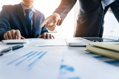 Administrator business man financial inspector and secretary making report, calculating or checking balance. Internal Revenue. Service inspector checking royalty free stock photography