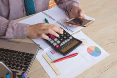 Administrator business man financial inspector and secretary making report, calculating or check balance. Internal Revenue Service Royalty Free Stock Images