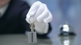 Administrator showing keys to Booked room, luxury hotel, rental for tourists. Stock footage stock footage