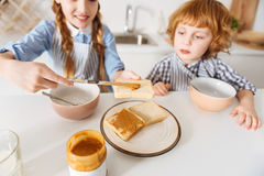 Admirable active siblings having a nutritious breakfast Royalty Free Stock Photos