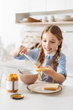 Admirable charming girl cooking nutritious breakfast Stock Photos