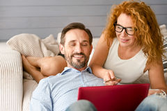 Admirable husband and wife working at home Royalty Free Stock Photo