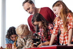 Admirable professional teacher assisting his students Stock Photo