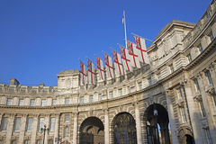 Admiralty Arch. Decorated with White Ensign flags in central London, England, United Kingdom Royalty Free Stock Photo