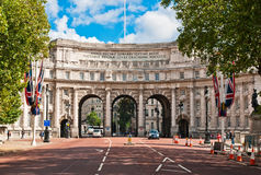 Admiralty Arch Building in London. Admiralty Arch is a large office building in London which incorporates an archway providing road and pedestrian access between Stock Photography