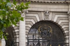 Admiralty Arch in London, England - detail of central gate and Royal coat of arms stock image