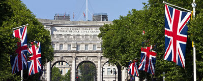 Admiralty Arch and Union Flags in London. Admiralty Arch and Union Flags down The Mall in London Royalty Free Stock Photo