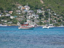 Admiralty bay at bequia in the caribbean. Yachts and hillside houses at the island of bequia in the windward islands royalty free stock image
