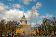 Admiralty building in the center of St. Petersburg, Russia. Fountain in front of the tower in sunny day. Tinted photo. Royalty Free Stock Image