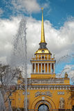 Admiralty building in the center of St. Petersburg, Russia. Fountain in front of the tower in sunny day. Tinted photo. Royalty Free Stock Photography