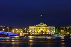 Admiralty building and  Palace  Bridge in St. Petersburg at nigh Stock Image