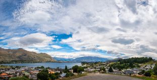 Admire the view from the War Memorial in Wanaka, NZ. View of Wanaka lake and alpine resort town with  the mountain range in the background from the Wanaka War Royalty Free Stock Photography