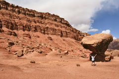 The admired tourist before a grandiose rock. From red sandstone. USA Stock Photography