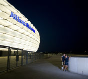 Admiring Allianz Arena at night. Two sports fans, a father and son, admiring famous football arena at night. Allianz Arena, Munich, Germany stock image