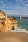 Admiring amazing stunning sea caves cliffs on sandy camilo beach in blue sky Stock Image
