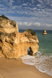 Admiring amazing stunning sea caves cliffs on sandy camilo beach in blue sky Stock Images