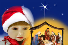 Admiring girl & miracle christmas, nativity scene. Royalty Free Stock Photography