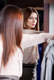 Admiring herself at the looking-glass Royalty Free Stock Photo