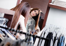 Admiring herself at the mirror Royalty Free Stock Images
