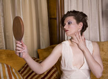 Admiring Herself In The Mirror Royalty Free Stock Photography