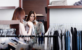 Admiring herself at the mirror Royalty Free Stock Image