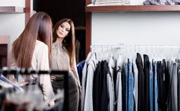 Admiring herself at the mirror in the store Royalty Free Stock Image