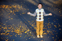 Admiring little boy laughing at beautiful autumn Royalty Free Stock Image