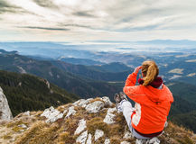 Admiring the majestic view. From the top of the mountains royalty free stock image