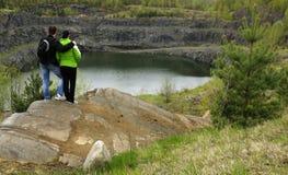 Admiring the mine lake Stock Photos