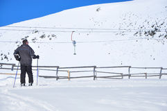 Admiring scenery. Image of a middle age skier admiring the scenery Royalty Free Stock Photos