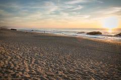 Admiring scenic sunset in blue yellow orange sky background on atlantic coast, capbreton Stock Image