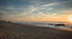 Admiring scenic sunset in blue yellow orange sky background on atlantic coast, capbreton Royalty Free Stock Images