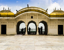 Admiring the Taj Mahal from the golden pavilions of Agra Fort Royalty Free Stock Images