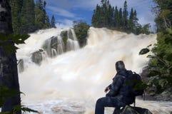 Admiring the waterfall royalty free stock photo