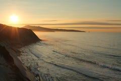 Admiring wonderful sunset on atlantic coast on the ledge in horizontal view Royalty Free Stock Image